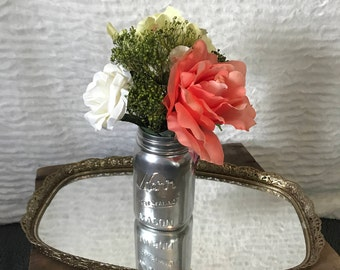 Small Floral Arrangement with Large Peach Colored Rose, White Rose, Green Hydrangea, and Ornamental Grass in a Chrome Painted Mason Jar