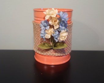 Salmon pink upcycled tin can with burlap and flowers