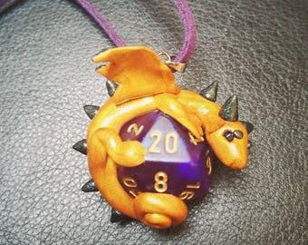 Golden d20 dragon charm