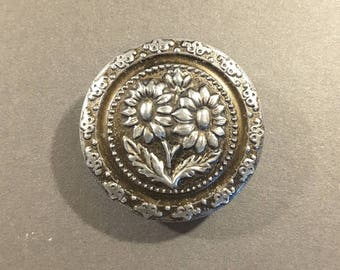 Early 1900's pressed metal button of sunflowers.
