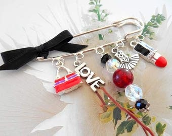 Brooch pin red fashion charms.