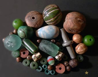 44 molten glass, wood, seeds, bauxite and metal African beads