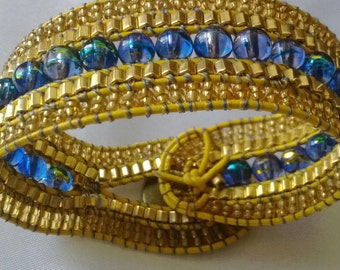Style wrap bracelet 5 rows of blue and gold