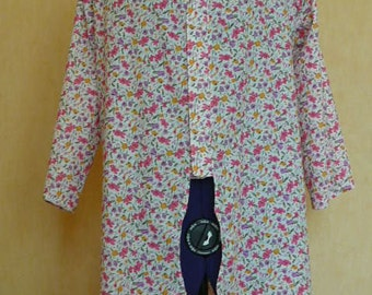 tunic cotton purple, pink and orange flower are white.