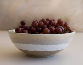 Large handmade beige and white country-chic pottery bowl, made with speckled stoneware clay.