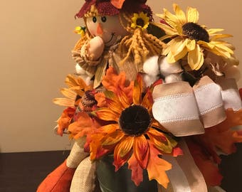Giggling girl scarecrow.