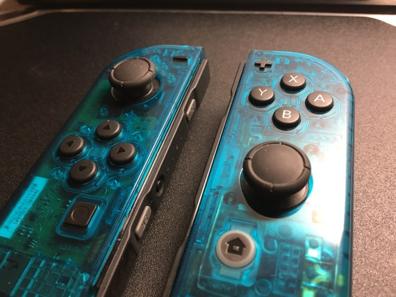 how to change the player on a nintendo joy con