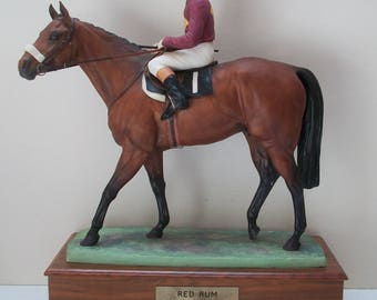 Red Rum Winner of grand national three times .