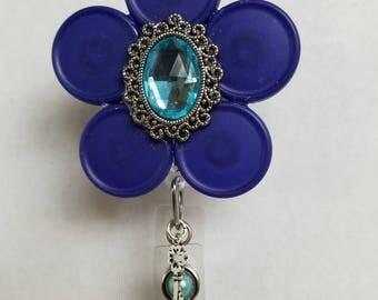 Blue flower badge holder