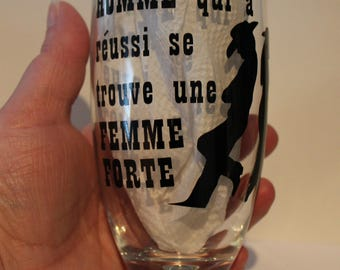 """Glass beer glass foot """"behind every man who has it is a strong woman."""