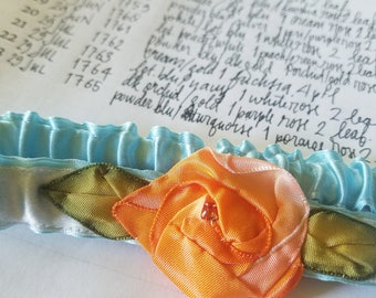 silk garter in powder blue and turquoise with a hand stitched pink and orange ribbon rose