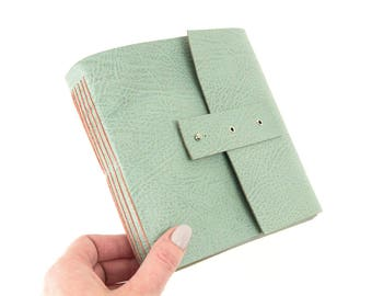 Pastels Sketchbook: Square Longstitch leather book in Duck Egg with Coral stitching and pastel paper. Handmade in England, ships worldwide.