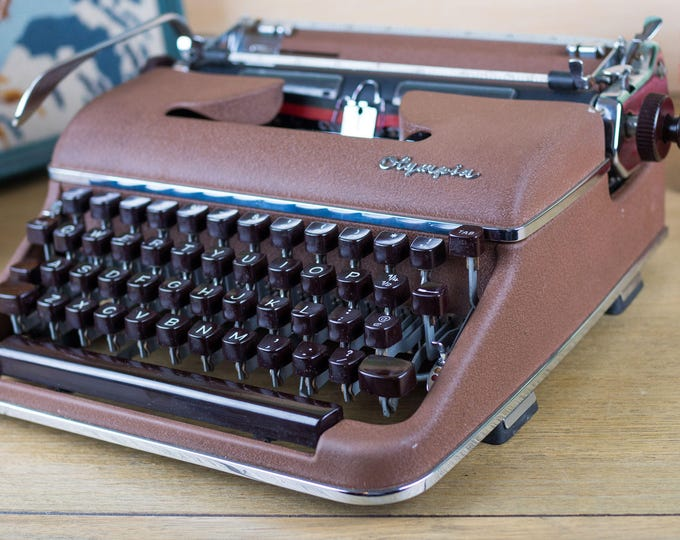 Featured listing image: Olympia SM3 DeLuxe Typewriter - Mid-Century Modern