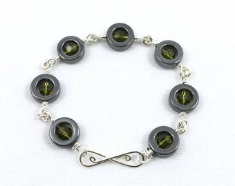 Hematite and Olive Crystal Beaded Bracelet in Sterling Silver with Infinity Clasp