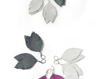 Suede leather feather earrings in fuchsia pink, light grey or pigeon grey.