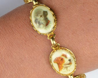 70s bracelet with dog illustrations. Child's or small adult. Irish Setter, German Shepherd, Poodle, Fox Terrier, Schnauzer. Vintage dogs