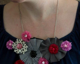 grey and pink rosette necklace