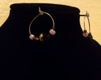 Gold hoop earrings with purple glass beads
