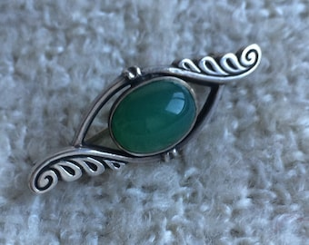 silver vintage brooch with green onyx stone