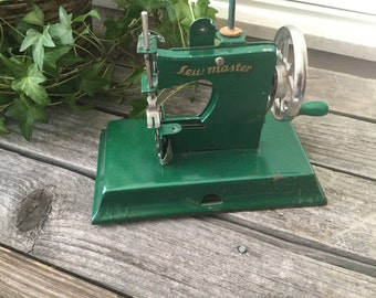 vintage childs toy sewing machine sew master