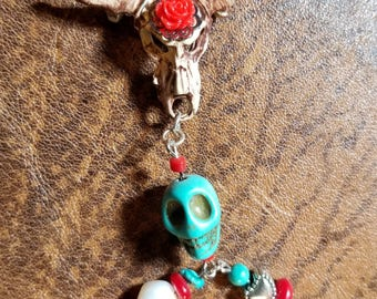 Southwest inspired hand painted cow skull and charms.