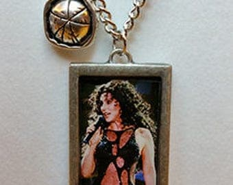 Cher Turn back time necklace.