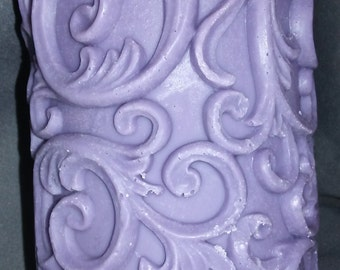 Carved decorative pillar candle. Great for any room in the house.