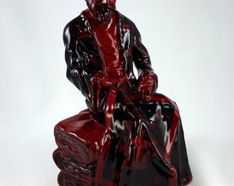 Royal Doulton Carpet Seller Seated Flambé # HN3277