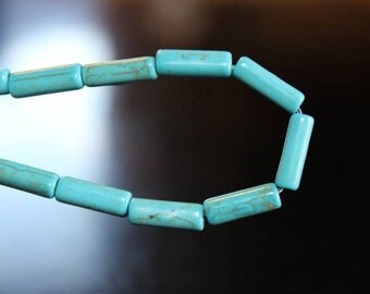32 synthetic turquoise beads, dyed, column, 13 x 4 mm, 1 mm hole