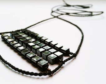 cube + silver | @tanyadasilvastudio | adjustable necklace | polished hematite + recycled sterling silver + waxed thread