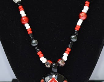 Red & Black Round Glass Pendant With Flower