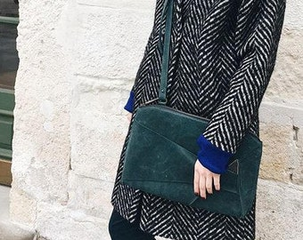 Bottle green leather zipped clutch with detachable strap
