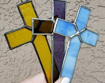 Stained Glass Crosses in Purple, Yellow, and Light Blue