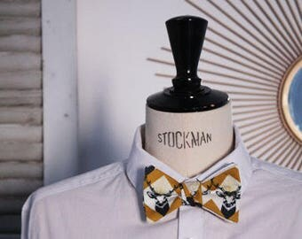 Tied bow tie graphic patterns and deer head.