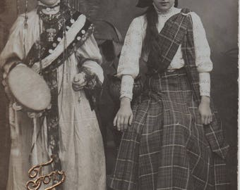 Ladies in costume, Scottish, tartan kilt, Chinese, headdress, tambourine, fancy dress, postcard, social history, Auld Lang Syne (rppc/gl266)