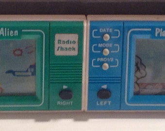 Vintage Radio Shack Mini Video Games from 1980's. 2 Rare Games. Space Aliens and Planes & Tanks. Crafts by the Sea and Island Images Studio