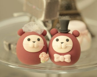 Otters wedding cake topper