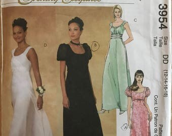 McCalls 3954 - Evening Elegance Raised Waist Dress with A-Line Skirt and Sleeveless or Short Puff Sleeves Option - Size 12 14 16 18