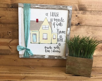 """Hand painted """"House of beams"""" sign."""