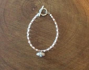 Beaded bracelet with football charm