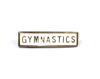 Vintage small gymnastics pin, small gymnastics badge, white enamel gymnastics brooch, school gift, gym gift, white pin, gymnast