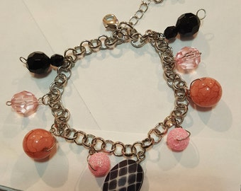 Silver bracelet with black and pink beads