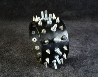 FREE SHIPPING! Men's bracelet for rockers, goth, punk and heavy metal fans with cone spikes and bolts