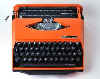 Vintage Karmann Ghia Super G | Smith Corona Portable typewriter 1970s - Orange