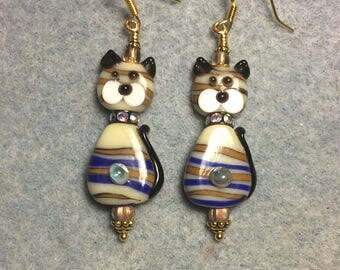 Tan and blue striped lampwork cat bead earrings adorned with a rhinestone collar and tan Czech glass beads.