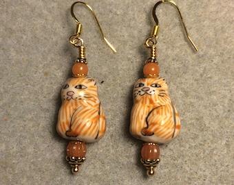 Orange ceramic tabby cat bead dangle earrings adorned with orange Czech glass beads.
