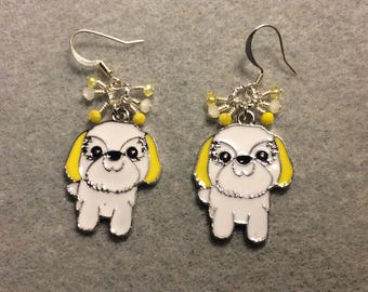 White and yellow enamel Shih Tzu charm earrings adorned with tiny dangling white and yellow Chinese crystal beads.