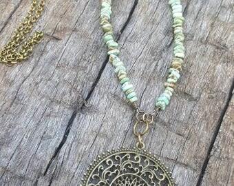 Boho style Necklace. Features Turquoise Howlite beads & Mandala pendant
