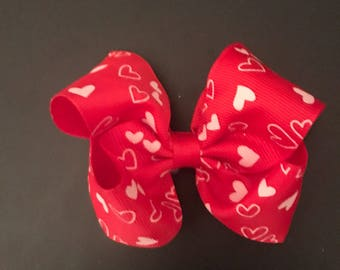 Valentines Day bow with a lined alligator clip on the back