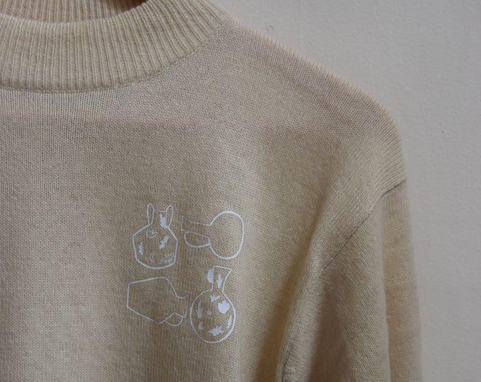 Daia Vase Cropped Mock Neck Sweater.